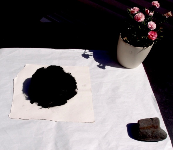 table top arrangement (bideford black wool ball, pink carnations and stone; p ward 2013)